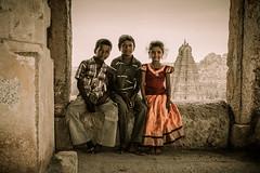 Sitting with Religion! (harish b shetty) Tags: portrait india art abandoned monument beautiful canon children temple eos ruins worship god expression religion efs1855mm express hampi southindia mantap gopura 1100d