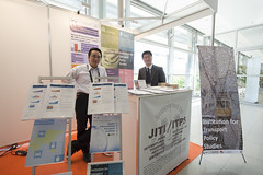 Exhibitors present the Japan International Transport Institute stand at the exhibition