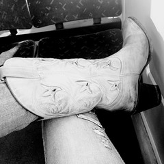 Cow girl on a train (Jitol) Tags: sexy train legs boots jeans cowgirl tight