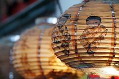 Glowing gold in the shopping street (Eric Flexyourhead) Tags: street city urban detail japan japanese bokeh  lantern hiroshimaken onomichi fragment shoppingstreet chochin 75mm shotengai zd  chugoku    olympusem5 mzuikodigital75mmf18 onomichishi