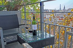 Romantic Afternoon on our Balcony (Jan Nagalski (jannagal)) Tags: flowers paris france reflection view wine balcony blossoms eiffeltower romance romantic wineglass railing winebottle yellowflowers patiofurniture bordeauxwine baronphilippederothschild canon60d jannagal jannagalski moutoncadetwine canon24105mmwine