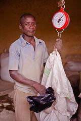 Selling animal food | Uganda (ReinierVanOorsouw) Tags: africa portrait canon portretten capital east afrika 5d canon5d uganda kampala portret bbm eastafrica fotograaf travelphotography beyondborders portraitphotography portretfotografie ouganda oeganda 5dmarkii  canon5dmarkii texttochange  beyondbordersmedia  jamhuriyauganda ugandai