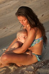Breastfeeding on the beach at sunset (4polinka) Tags: ocean life travel family boy sunset sea summer vacation people woman baby cute love beach nature beautiful childhood mom happy milk kid healthy holding support toddler infant breast child feeding outdoor sandy young mother adorable peaceful happiness son parent together contact concept breastfeeding care conceptual motherhood parenting childcare caucasian