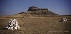 WHITE STONE MOUNDS ON THE BATTLEFIELDS AT ISANDLWANA, NATAL, SOUTH AFRICA. (IMAGES OF WALES.... (TIMWOOD)) Tags: africa homes church natal club river army buffalo war gun south ground battle lord graves hut empire cannon burial british shield battlefield mound invasion baron zulu drift spear chelmsford 1879 anglo 1870 drakensberg kwazulu bloodshed tugela zululand zulus rorkes isandlwana lordcarnarvon gattlinggun connical cetshwayo sirhenrybartlefrere garnetwolseley pietersmaritzburg