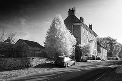 A North Yorkshire Village (johnhjic) Tags: johnhjic nikon d90 helperby northyorkshire ir house sky road car tree trees village yorkshire home clouds windows greatbritain blackwhite black white bw rails rail garden