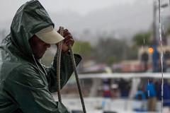 Boatman (fredrik.gattan) Tags: boatman boat man rain wet whale ship samana dominican republic rope coate misty harbour dock person cap