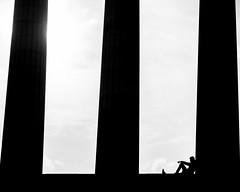 Taking a rest Edinburgh National Memorial. (James- Burke) Tags: blackandwhite bw candid edinburgh nationalmonumentofscotland parthenon resting scotland seated silhouette street streetphotography columns