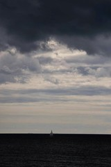 Solitude (niknak2016) Tags: beautyinnature naturalbeauty nature natural naturephotography seascape seaandsky sea seaphotography ocean oceanphotography water distance skyline skyscape sky skyphotography cloudsandsky whiteclouds darkclouds darksea horizon horizonoversea boat ship ships stleonardsonsea hastings solitary solitude vast alone