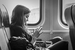 Text (John St John Photography) Tags: streetphotography candidphotography train 1162 njtransit youngwoman smartphone texting hand blackandwhite blackwhite bw