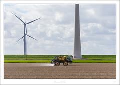 _DMC0197 (duncen.mcleod) Tags: d4 holland nederland nikkor nikon noordoostpolder windmills windmolen windmühlen windpower windfarms windenergy windenergie turbine windpark windenergieanlage niederlande outdoor paybas 1424f28 1424 dutch europa wolken clouds mills sky agriculture agri sproeien trekker tractor