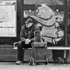 Don't look backwards...... (Akbar Simonse) Tags: denbosch hertogenbosch holland netherlands nederland graffiti busstop bushalte man people candid cap trolley streetphotography streetshot straatfotografie straatfoto zwartwit bw blancoynegro bn monochrome vierkant square akbarsimonse acdc pham