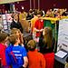 Visitors look on during a Rube Goldberg machine demonstration.