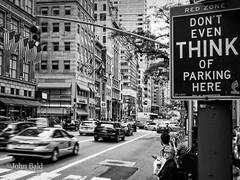 Don't Even Think Of It, New York City  (80302-BW) (John Bald) Tags: 5thavenue manhattan newyorkcity blackandwhite cityscape congestion midtownmanhattan noparking parking parkingsign street traffic urban woman