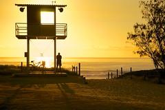 Early morning glow (Deb Jones1) Tags: ocean sunset sea beach nature water beauty silhouette yellow sunrise landscape gold surf australia explore beaches silohuette lifesaving brunswickheads byronshire cmwd debjones1