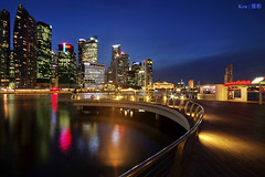 MBS Boardwalk (Ken Goh thanks for 1,900,000+ views) Tags: lighting longexposure blue sky cloud reflection water colors night marina landscape photography bay pentax district central smooth wideangle business hour cbd sands 1020 mbs k3 simga
