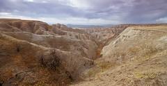 Badlands Dramatic.jpg (Eye of G Photography) Tags: usa grass rock southdakota places northamerica badlands skyclouds