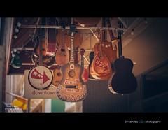Finest Service & Repair (jimservies | photography) Tags: tn knoxville guitar guitars banjo hanging knoxvilletn leica100mm leica100 leicaapomacroelmaritr100mmf28 leicaapo jimserviesphotography