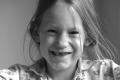 Lost another tooth! (d_t_vos) Tags: blackandwhite bw white black girl smile face laughing tooth lost happy teeth joy happiness blond laugh blonde littlegirl freckles pajama pijama softlight lostatooth dickvos dtvos