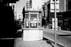 Ticket Booth Olympia Theater (Phillip Pessar) Tags: camera bw white black film analog 35mm store florida zoom kodak miami infinity tx trix olympus x thrift 400 tri 70