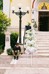 Funeral Wreaths (Jackobo) Tags: door people white man church entrance icon athens beggar greece virginmary 2485mmf3545 funeralwreaths stockcategories