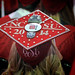 Mortar board, bejeweled and bedazzled, celebrates the clogger graduating.
