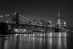 Brooklyn Bridge & Freedom Tower at Night (keithpk) Tags: ocean city nyc newyorkcity sky urban bw black water night buildings dark blackwhite waves cityscape carousel citylights brooklynbridge bigapple freedomtower janescarousel brooklybridgepark