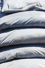detail of plastic bags heap (Mimadeo) Tags: industry retail bag concrete construction sand closed industrial group gray cement large row stack warehouse plastic business transportation packaging material merchandise sack shipping heavy package heap burlap construct