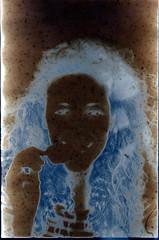 the girl with the popsicle_nesitive (Max Miedinger) Tags: bw film secret experiment slide dia sw posterization v500 epsonv500 pogative nesitive