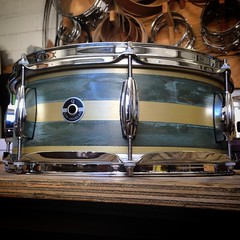 5.5X14 brass plate with a couple patina stripes. Don't let the depth fool you. This has a huge range due to the 8 lug configuration. One of the best sizes for an all around work horse. #qdrumco #brass #plate #snare