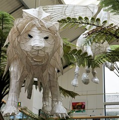 A lion in Truro (Explored) (radleyfreak (offline for a while)) Tags: shoppingarcade truro cornwall lion display ferns hanging lantern cityoflights explored midwinter festival november annual parade