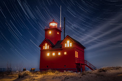 Holland's Big Red (Jerry James.) Tags: bigred holland michigan lighthouse landscape startrails nightphotography longexposure jerryjames olympus em5markii