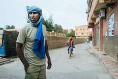 Heating. (Marziolino) Tags: people portrait marocco street bike road