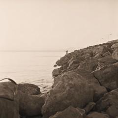 Fisherman (Franco & Lia) Tags: alghero sardegna sardinia pescatore fisherman analogico pellicola film analog argentique ilford fp4 rolleiflex planar biancoenero blackandwhite noiretblanc seppia sepia epson v500