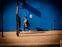 Twilight Zone (BigRedTroll) Tags: blue color contrast contrasty disappear people quirky shadow streetphotography walking woman