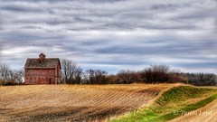 Iowa Crib (Justin Loyd Photography) Tags: corncrib farm farmers farmyard red landscape iowa boonecounty spring clouds old aged building flickr photography blue canon6d 24105l cloudy eos april field trees gravel ditch ngc