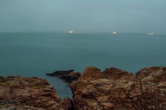 Gloomy Shore (William Chils) Tags: gloomy fog rocks water beach earthy