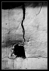 CRACK IN THE PLASTER. 1 (adriangeephotography) Tags: old roof building brick wall tile photography surrey damage adrian gee farnham adriangeephotography