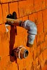 Plumber needed (halifaxlight) Tags: shadow red canada rust novascotia shingles plumbing pipe shed sunny disconnected northwestcove ilovemypics vanagram