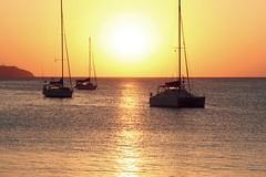(flauschviech) Tags: light sea summer sun beach nature water stone island boat spring ship sundown yacht ibiza