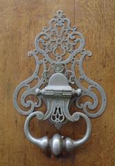 Ornate gray metal heurtoir on wood - Bordeaux (Monceau) Tags: wood metal gray bordeaux ornate heurtoir