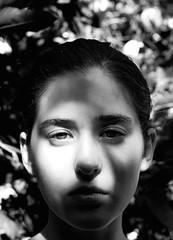 A Silhouette (Erin Stoodley) Tags: light blackandwhite white black tree face leaves fruit hair eyes afternoon shadows darkness skin lips lemons cheeks lightness