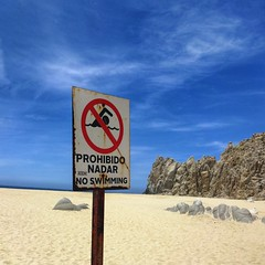 Prohibido Nadar ! (StartTheDay) Tags: travel blue light red sea sky white holiday color beach sign yellow swimming mexico los sand rust rocks waves colours notice decay no icon nadar prohibido catchy cabos