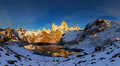 Panorama : Fitz Roy and Laguna de los Tres (baddoguy) Tags: panorama patagonia mountain lake snow reflection argentina sunrise fitzroy images getty massif losglaciares lagunadelostress