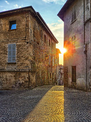 Rays (Carlo Err) Tags: street city light shadow sun building abandoned wall architecture contrast sunrise dawn daylight town twilight ancient alley ruins cityscape shadows shine sundown dusk ruin 100v10f rays walls dawning setting corrosion sunray urbanlandscape raysoflight