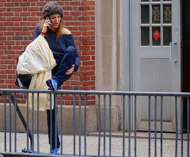 newyork manhattan cellphone sneakers smartphone cap railing streetsofnewyork everyblock