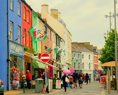 A street in Wales (Mclain de Vera) Tags: street uk people colors wales bright unitedkingdom candid vivid busy rainy