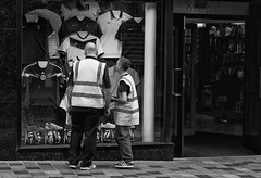 Like Father Like Son (VelvetJones_) Tags: street blackandwhite bw white black sport boot scotland football glasgow candid father balls son nike vests