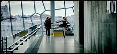 Impromptu Ballet (Sheer Poetry) Tags: ballet dancer reykjavik harpa windows concrete yellow spin pirouette tutu