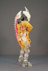 Freya - Side (0nuku) Tags: bionicle lego toa crystal quartz pink gold clear crast kanohi custom mask prosthetics amputee
