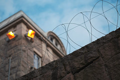 Jailtime (Jani M) Tags: street urban jail blue sky barbed wire diagonal prison lamp
